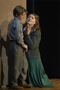 Jakob Janutka as John, Peter Grimes's apprentice, and Ileana Montalbetti as Ellen Orford in the Canadian Opera Company's 2013 production of Peter Grimes