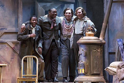 (l – r) Vuyani Mlinde as Colline, Michael Sumuel as Schaunard, Dimitri Pittas as Rodolfo and Joshua Hopkins as Marcello in the Canadian Opera Company/Houston Grand Opera (HGO)/San Francisco Opera co-production of La Bohème, 2012, HGO. Photo: Felix Sanchez